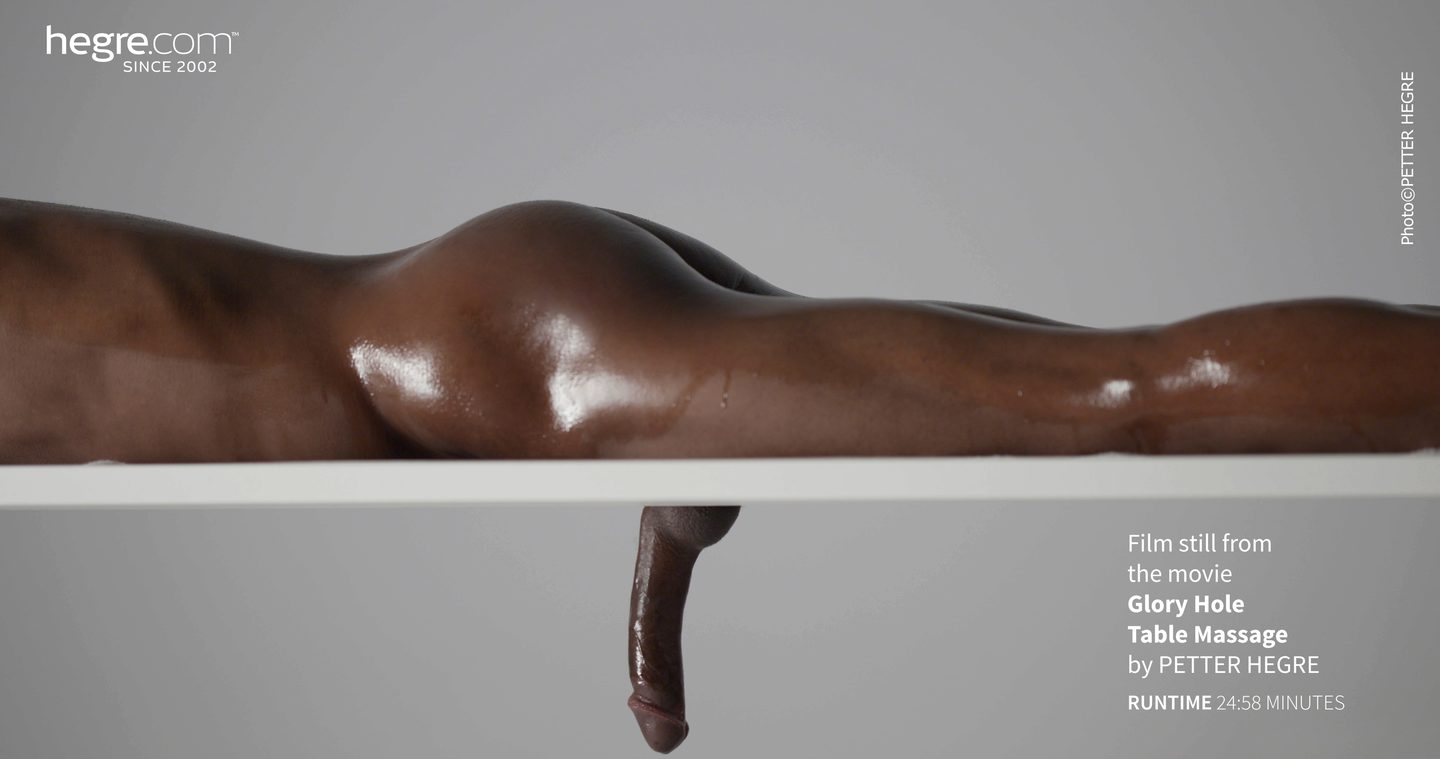 Massage table with penis hole